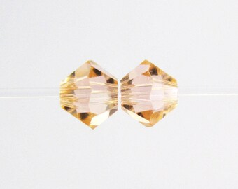 LT PEACH 6mm Swarovski Crystal Bicones, Light Peach Bicones, Article 5301, 36 pcs