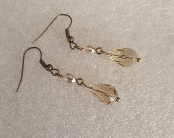 Brown crystal dangle earrings on bronze ear wires