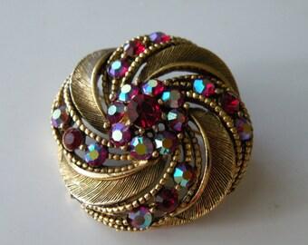 Lisner round swirl red rhinestone brooch pin