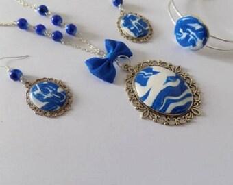 set a long necklace, bracelet earrings