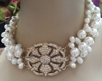 three strand fresh water pearl necklace with a remake of center shoe buckle