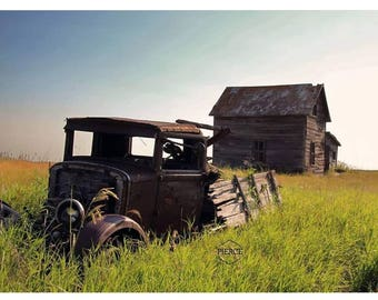 A beautiful photograph of a abandoned house and truck in Saskatchewan