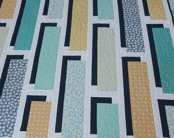 Three D extra large lap quilt with turquoise, gold, navy and white 70 x 84