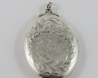 Sterling Silver Large Oval Locket Pendant With A Floral Motif On The Front