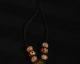 A Glass Beaded Pendant with A Leather Necklace