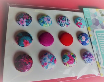 12 plain and fancy flower fabric buttons