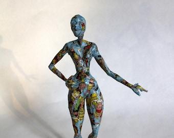 Contemporary sculpture of a woman in papier mache