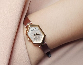 Titan Hexad | Vintage petite women unique style watch in gold hexagon bezel, silver pattern face, brown leather strap | Ladies gift ideas