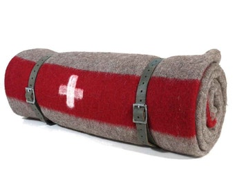 THE original Swiss Army Blanket. Excellent  for decoration,as  throw blanket ,for picnics and camping