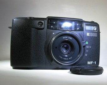 Extremely Rare Ricoh MF-1 (35R) 30mm Lens 35 mm Film Auto Focus Camera with Manual Shutter Speed and Focus capabilities