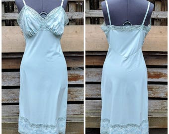 Vintage 1950 or 60s aqua ocean blue Van Raulte 100% nylon and embroidered lace detail slip size 32
