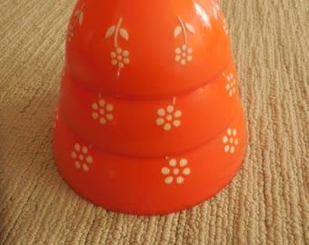 Three Kitschy Nesting Orange and White Bowls