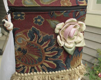 A hand sewn tapestry bag, tapestry purse, small purse, small handbag, cross body bag, small messenger bag with bottom fringe and silk rose.