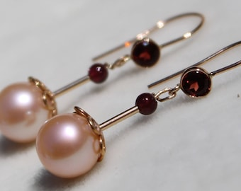 Gold earrings with pink round pearl and 14K gold bezeled round garnets