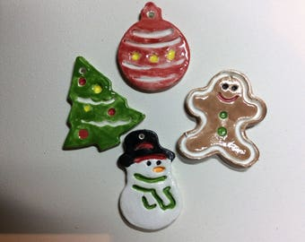 Assorted ceramic Christmas gift tags or ornaments. Five dollars for a 4 ornaments and free shipping