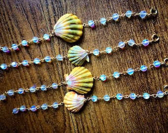 14k gold filled Hawaiian sunrise shell bracelet with clear iridescent glass beads.