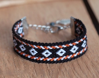 Black ethnic bracelet, Native american indian, Orange white ikat aztec wayuu, Boho fiber jewelry, Eclectic wrap bracelet, Leaf tribal charm