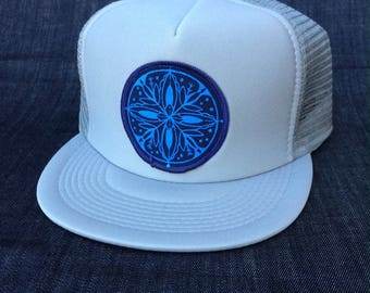 UNS designs Trucker hat with Snowflake patch.