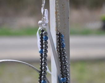 silver and blue beaded necklace with ribbon
