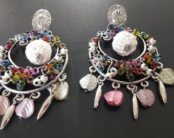 Earrings pierced with beads and charms