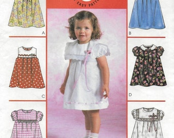 A Sleeveless or Short Sleeve A-line Dress with Collar, Tuck and Trim Variations Pattern for Toddlers: Uncut - Sizes 1-2-3-4 ~ McCall's 4353