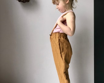 The Workwear Trouser. Unisex Toddler & Childrens hand dyed ginger linen pants with plaited braces.