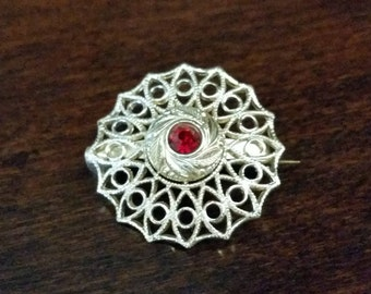 Vintage Gold Tone Floral Filigree Brooch with Red Rhinestone