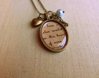 Johnny Cash.  I keep a close watch on this heart of mine.  Brass Necklace.