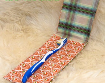 Pocket unisex toothbrush with Interior and orange peacock feathers in oilcloth