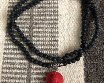 Tibetan prayer beads  mala  lava beads and buddha pendant