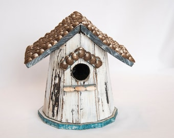 Antique bird house with shell shingles