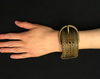 Recycled leather cuff  bracelet with belt buckle closure.