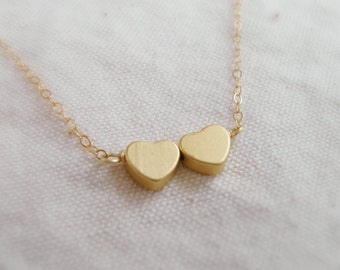 Je T ' aime Two Sisters (necklace) - Two small 14k gold plated puffed hearts and 14k Gold Filled chain