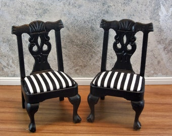 Dollhouse miniature furniture in twelfth scale or 1:12 scale.  Black dining chair with black & white stripped fabric seats.   Item #162.