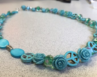 Turquoise rose and peace sign necklace.