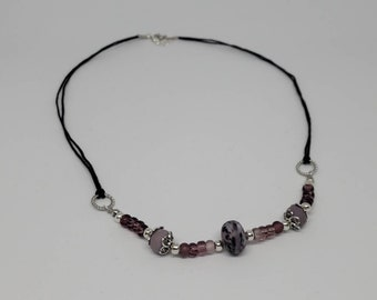 Purple lampworked glass necklace.