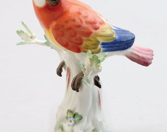 A Meissen Porcelain Figure Of A Red Parrot, 1949