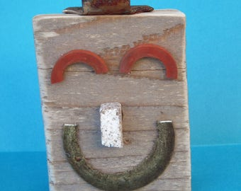 Mixed media face art, wood block, found items, wall mask, happy face, recycled, rectangle art, distressed, smile face, sculpture
