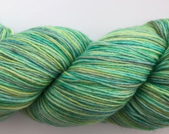 Hand dyed yarn in gentle blues and greens with a hint of yellow. BFL, nylon.
