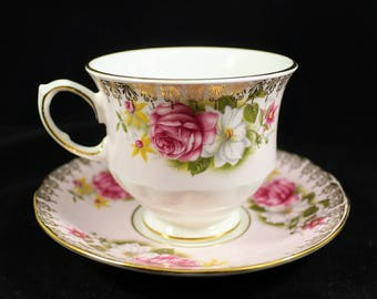 Vintage Bone China Queen Anne England Teacup G374 and Saucer H376 Floral Pattern with Stylized gold edge trim Pattern No. 8558