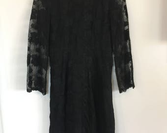 AMAZING black lace dress. Very elegant. Sheer sleeves and fitted waist. High neck. Size M.
