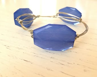 Bright blue bead on silver wire
