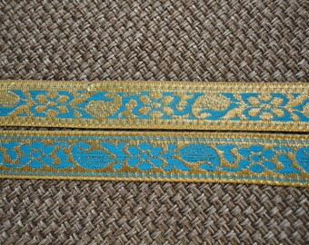 New, light blue and gold trim has flowers, 2 cm wide