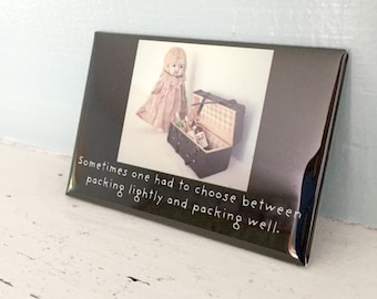 Adventures of Claudia China Doll Magnet Packing Well Photography Wine Humor