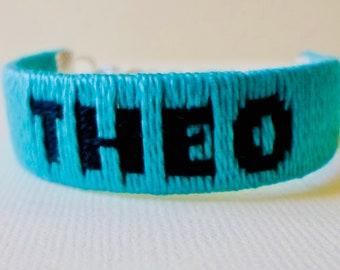 Bracelet made of threaded with custom name writing
