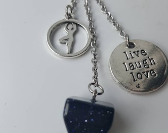 "Stone Keychain thin blue aventurine yoga charm and ""live laugh love""."