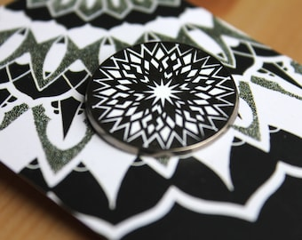 Limited edition black nickel and white enamel pin - mandala design