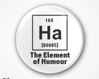 Ha The Element of Humour Pin Badge or Magnet. Available as a 3.8cm Badge or magnet