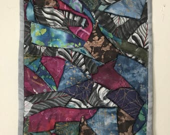 QUILTED WALL ART resembling Stained Glass