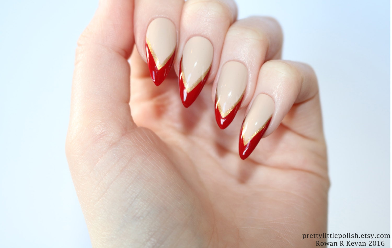 Nude stiletto nails red & gold tip Nude stiletto nails Nude